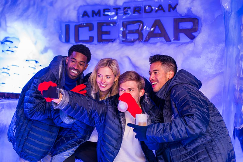 tourist group holding icebar Amsterdam