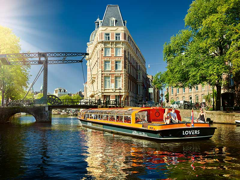 Tourist Group Holding Lovers Canal in Amsterdam