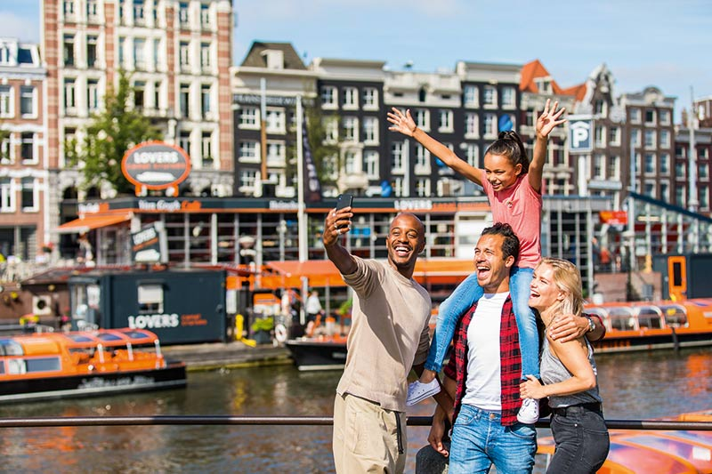 Tourist Group Holding Walking Tour Amsterdam